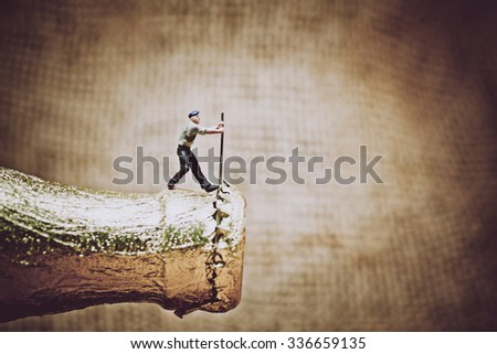 Miniature worker opening a beer bottle. Color tone tuned photo. Macro photo - stock photo