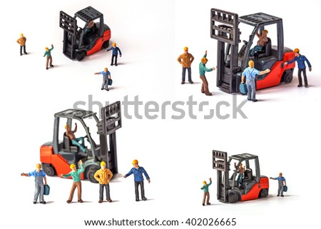 miniature worker with standing front of forklift machine, on white background. - stock photo