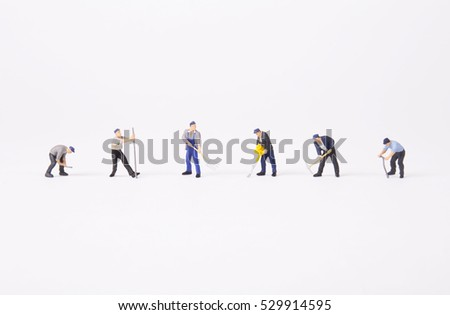 Miniature workers isolate on white background