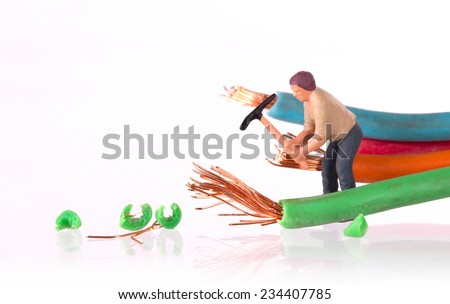 Miniature workers with pickaxe working on a broken cable - stock photo
