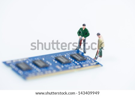 Miniature workmen working on the computer RAM, Random Access Memory, component over white background - stock photo