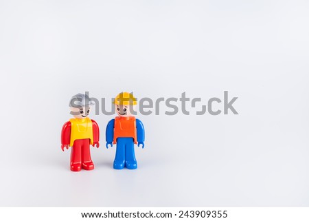 Miniatures of construction workers isolated on white background  - stock photo