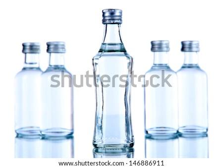 Minibar bottles, isolated on white - stock photo