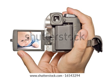 miniDv camera in man hands with baby image on display - stock photo