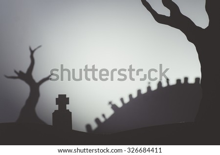minimal halloween scene graveyard and old trees paper craft - stock photo