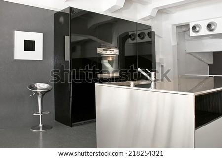 Minimalism design of modern big black kitchen - stock photo