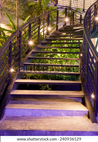 minimalism style stairs with night lighting in garden - stock photo