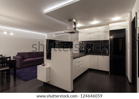 Minimalist apartment - kitchen connected with living room - stock photo
