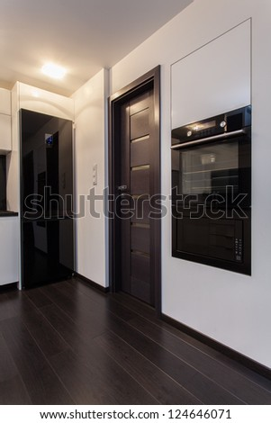 Minimalist apartment - stove, microwave oven - stock photo