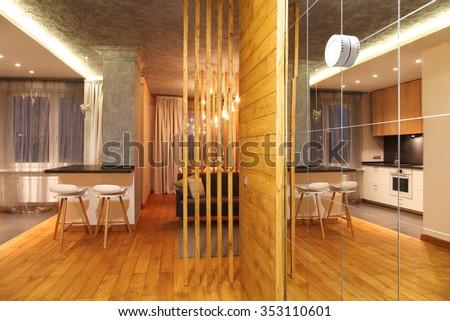 Minimalist interior studio apartments with concrete walls and parquet floors - stock photo