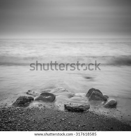 Minimalist Seascape. Coastal Sunrise. Black and white. - stock photo