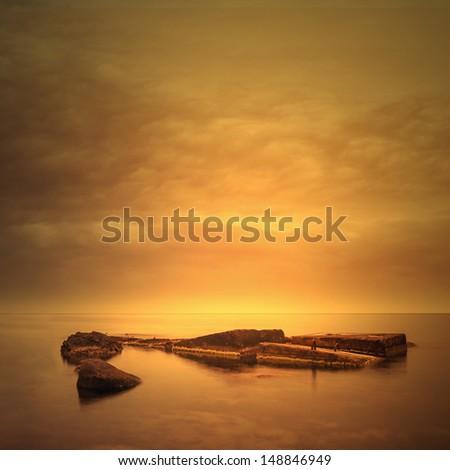 Minimalist seascape with sunrise - stock photo