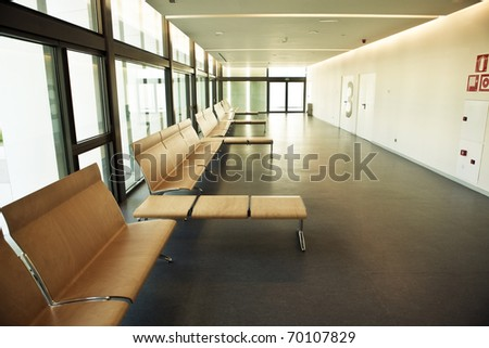Minimalist waiting room with a big number 3 - stock photo