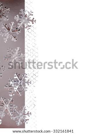 Minimalistic Christmas Border. Metallic Snowflakes over White Background. Selective Focus. Space for Text. - stock photo