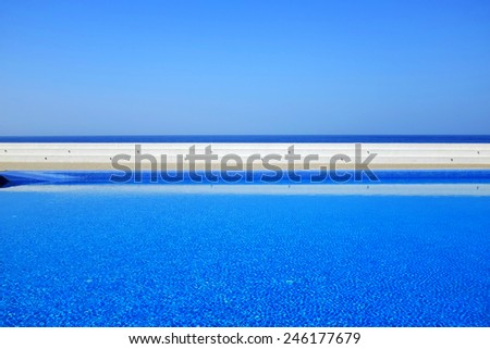 Minimalistic shot of a pool overlooking the sea - stock photo