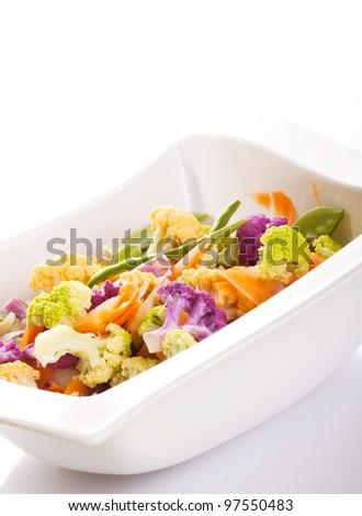 Minimalistic shot of fresh salad with vegetables on white background - stock photo