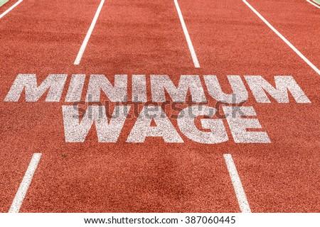 Minimum Wage written on running track - stock photo