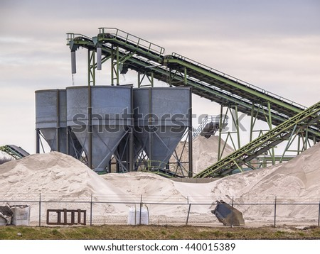 Mining belts are sorting sand on a construction site