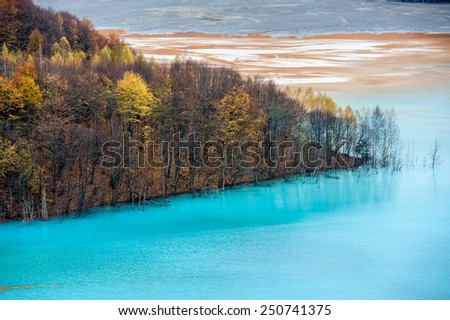 Mining disaster and water pollution in Romania. Water pollution.  Copper mine exploitation.  - stock photo