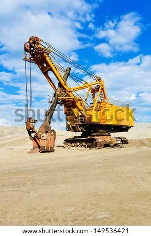 Mining industry machine - vintage excavator  - stock photo
