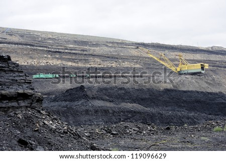 Mining, mining industry, the excavator to load - stock photo