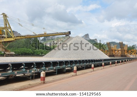 Mining, Quarry, Limestone stock pile and reclaimer - stock photo