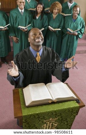 Minister Praying to God - stock photo
