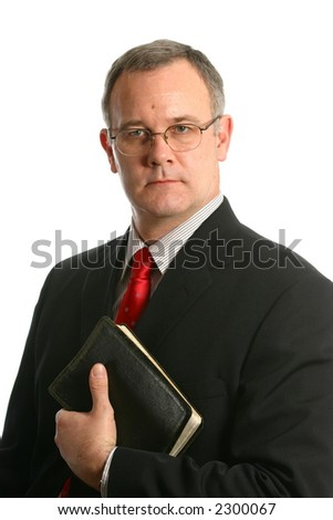 Minister with black Bible - stock photo