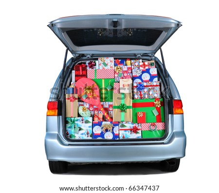 Minivan with its rear door open and stuffed full with wrapped Christmas presents. Square format isolated on white with shadow under vehicle. - stock photo