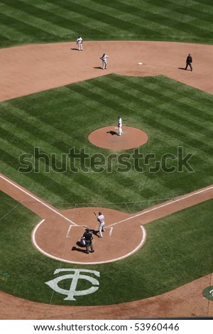 MINNEAPOLIS - APRIL 22: A Twins pitcher stares down a Cleveland Indians batter at Target Field, the new outdoor ballpark in the Twin Cities on April 22, 2010 in Minneapolis, Minnesota. - stock photo