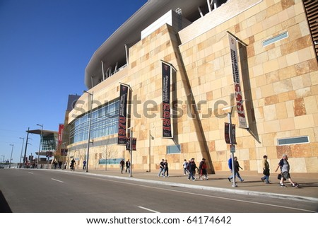 MINNEAPOLIS - APRIL 21: Fans arrive at new Target Field, home of the Minnesota Twins, a ballpark that returns outdoor baseball to the city, on April 21, 2010 in Minneapolis, Minnesota. - stock photo