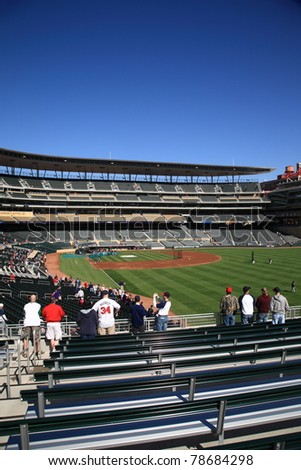 MINNEAPOLIS - APRIL 22: Target Field, the new outdoor stadium of the Minnesota Twins, on April 22, 2010 in Minneapolis, Minnesota. The ballpark seats 39,504 and cost over $500 million to construct. - stock photo