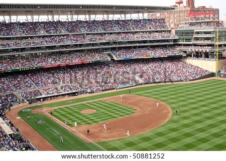 MINNEAPOLIS - APRIL 12: The Minnesota Twins play the Boston Red Sox in the first regular season game  played at Target Field on April 12, 2010 in Minneapolis. - stock photo