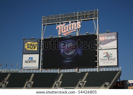MINNEAPOLIS - APRIL 21: Towering scoreboard at new Target Field, home of the Minnesota Twins, a ballpark that returns outdoor baseball to the city, on April 21, 2010 in Minneapolis, Minnesota. - stock photo