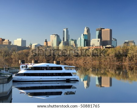 Minneapolis downtown with reflection in Mississippi at morning - stock photo