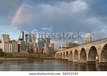 Minneapolis. Image of city of Minneapolis in the morning with rainbow. - stock photo