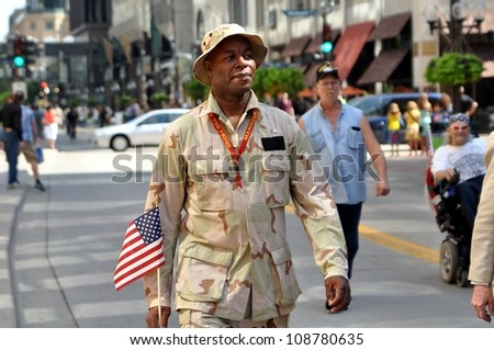 MINNEAPOLIS - JULY 28:  A proud veteran marches in the Twin Cities Heroes Parade on July 28, 2012, in Minneapolis.  The parade honors  post-9/11 veterans and active military. - stock photo