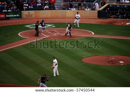 MINNEAPOLIS - JULY 17:  After Alex Rios of the White Sox scored, catcher Drew Butera of the Twins attempts to throw out Paul Konerko at second base at Target Field July 17, 2010 in Minneapolis, MN. - stock photo
