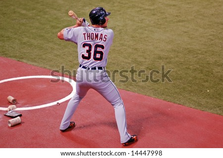 Minneapolis - July 1:  Clete Thomas of the Detroit Tigers on deck in a game against the Minnesota Twins on July 1, 2008 - stock photo