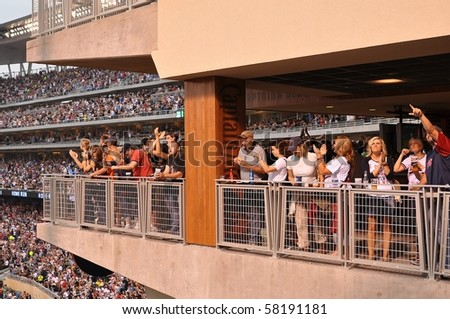 MINNEAPOLIS - JULY 30:  Minnesota Twins fans celebrate a home run against the Seattle Mariners at Target Field, on July 30, 2010 in Minneapolis. - stock photo