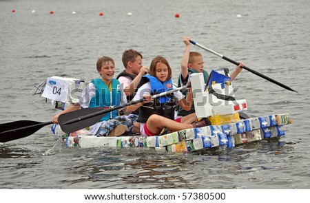 MINNEAPOLIS - JULY 18:  Young participants  in the Minneapolis Aquatennial Milk Carton Boat Race, on July 18, 2010 in Minneapolis. - stock photo