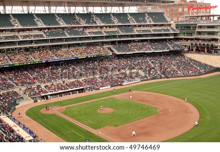 MINNEAPOLIS - MARCH 27:  The Univ. of Minnesota plays Louisiana Tech in the first baseball game ever played at Target Field, the new home of the Minnesota Twins, on March 27, 2010 in Minneapolis. - stock photo