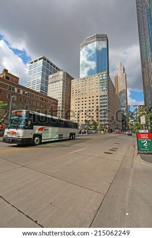 MINNEAPOLIS, MINNESOTA - AUGUST 11 2014: Metro Transit bus drives through downtown Minneapolis, the seat of Hennepin County and the largest city in Minnesota with over 400,000 residents. - stock photo