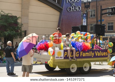 MINNEAPOLIS, MINNESOTA - JUN 30: DOWNTOWN OF MINNEAPOLIS , The Twin Cities of Minneapolis and St. Paul celebrate Gay Pride, on June 30, 2013 in Minneapolis, Minnesota.  - stock photo