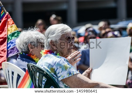 Minneapolis, Minnesota - June 30: Twin Cities LGBT Pride Parade 2013, in Minneapolis,MN, on June 30, 2013. Annual LGBT pride weekend parade, began at 10:30am on Hennepin Avenue. - stock photo