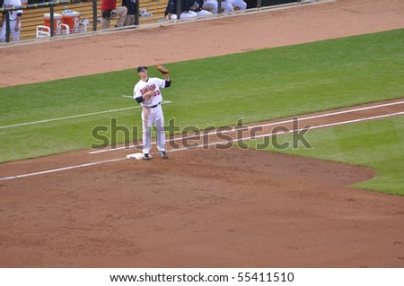 MINNEAPOLIS, MN - JUNE 15: 2006 AL MVP Justin Morneau of the Minnesota Twins at first base during a game against the Colorado Rockies on June 15, 2010 in Minneapolis, MN - stock photo