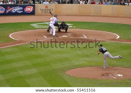MINNEAPOLIS, MN - JUNE 15: 2006 AL MVP Justin Morneau of the Minnesota Twins batting against Colorado Rockies pitcher Aaron Cook on June 15, 2010 in Minneapolis, MN - stock photo