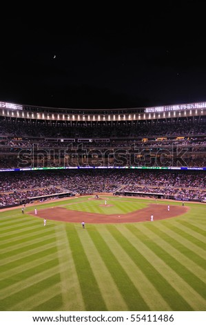 MINNEAPOLIS, MN - JUNE 15: View of Target Field at night during a Major League Baseball game between the Colorado Rockies and the Minnesota Twins on June 15, 2010 in Minneapolis, MN - stock photo