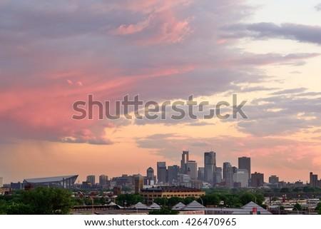 MINNEAPOLIS, MN - MAY 24 2016: Downtown Minneapolis Skyline with Minnesota Vikings US Bank Stadium at Sunset - stock photo