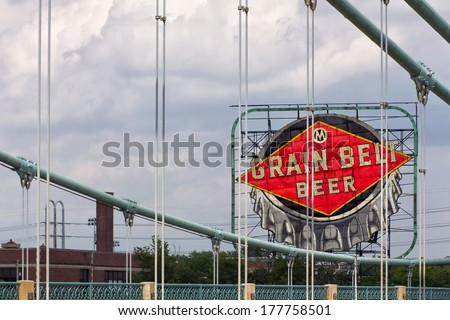 MINNEAPOLIS, MN/USA - AUGUST 6, 2011:  Grain Belt Beer sign over Nicollet Island in downtown Minneapolis. Grain Belt beer is brewed in the state of Minnesota by the August Schell Brewing Company. - stock photo